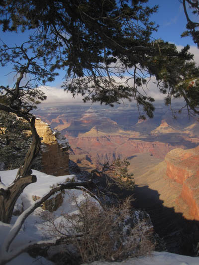 Grand Canyon tour feature photo. A beautiful view overlooking the Grand Canyon with some snow