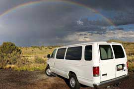 A rainbow over a Southwest Tours van while on tour